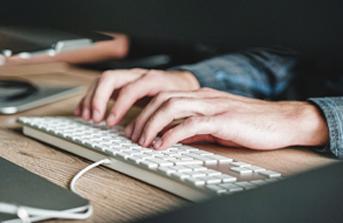 Node.js developer typing code