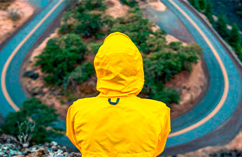Man in a yellow hoodie and a road